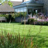 Tuinaanleg Wenduine - grassen en vasteplantenborders